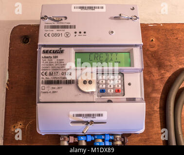 Secure Liberty 100 smart electricity meter, measuring consumption and relaying 'Credit' information via the display - Stock Photo