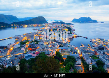 Colorful sunset in Alesund port town - Stock Photo