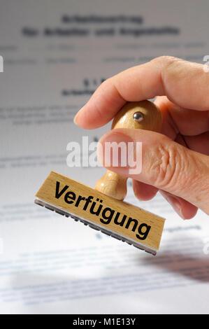 Stempel in Hand beschriftet mit Verfügung - Stock Photo
