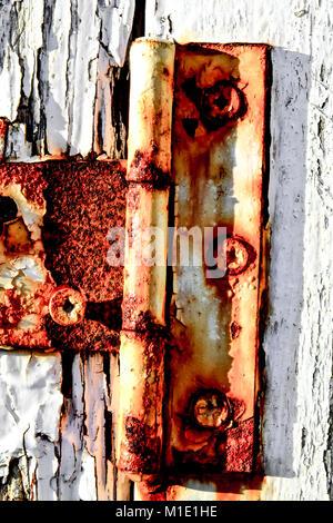 Rusty Hinges on White Door - Stock Photo