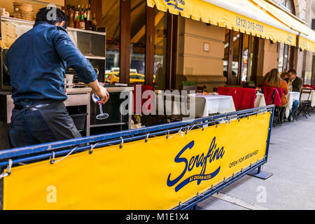 New York City, USA - October 28, 2017: Serafina restaurant open for breakfast yellow sign in Midtown Manhattan NYC, - Stock Photo