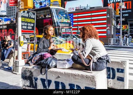 New York City, USA - October 28, 2017: Manhattan NYC buildings of midtown Times Square, Broadway avenue road, signs - Stock Photo