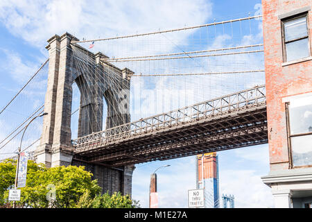 Brooklyn, USA - October 28, 2017: Closeup view of under Brooklyn Bridge outside exterior outdoors in NYC New York - Stock Photo