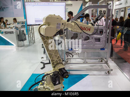 Bangkok, Thailand - November 22, 2017: Robot arm demonstrate spot welding car door in Metalex 2017 - Stock Photo