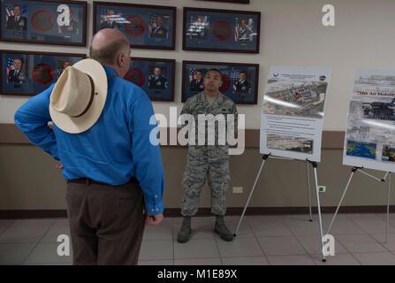 Airman 1st Class Joseph Alviedo, 734th Air Mobility Squadron, right, briefs Jay Hone, the husband of Secretary of - Stock Photo