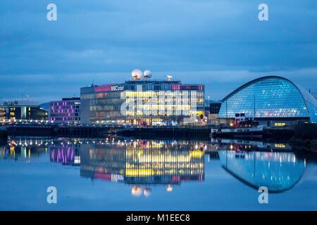 Night view of BBC Scotland Studio at Pacific Quay beside River Clyde  in Glasgow, Scotland, United Kingdom - Stock Photo