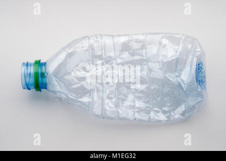 Single empty crushed plastic water bottle - Stock Photo