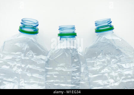 Three empty crushed plastic water bottles - Stock Photo