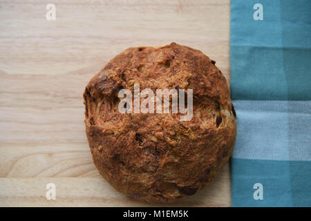 rustic food image of homemade and freshly baked artisan loaf of bread with cheese and bacon flavor on a natural - Stock Photo