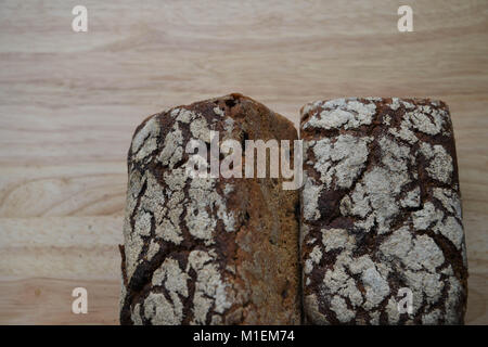 food of home made artisan bread flavored with raisin and rye for the dark color and with flour pattern top on a - Stock Photo