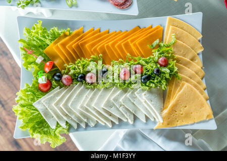 Salad with sausage, greens and other on table with white table. Catering concept. - Stock Photo