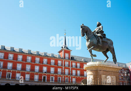 Spain, Madrid, the ancient palaces of Plaza Mayor with the equestrian statue of King Philip III - Stock Photo