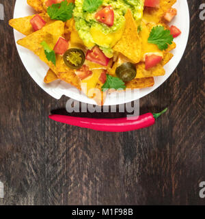 Nachos with cheese, traditional Mexican snack, with copyspace - Stock Photo