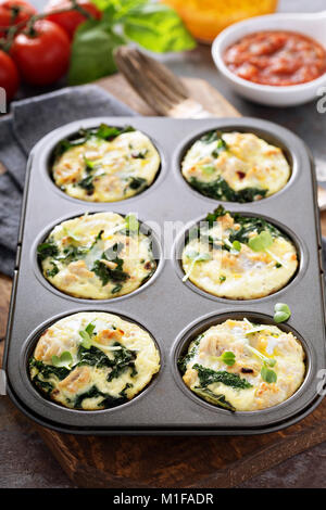 High protein egg muffins with kale and ground turkey in a muffin tin - Stock Photo