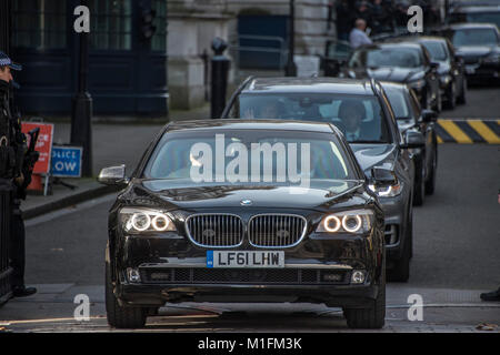 London, UK. 30th January, 2018. A queue of ministerial cars leave Downing street after this morning's Cabinet Meeting. - Stock Photo