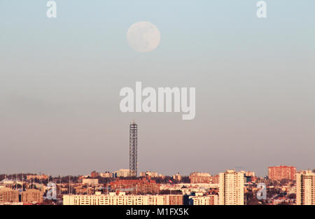 Leaside, Toronto, Canada. 30th Jan, 2018. Super Blue Moon rising over cellular tower in residential homes in Leaside, - Stock Photo