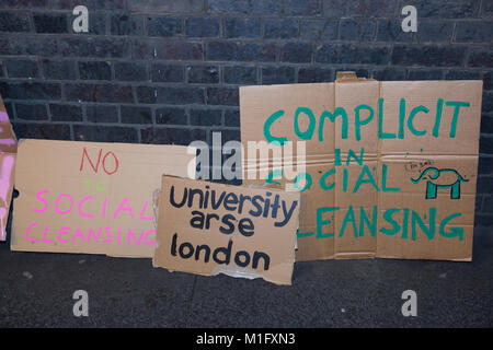 London, UK. 30th Jan, 2018. Signs used by students taking part in a carnival-style protest outside the offices of - Stock Photo