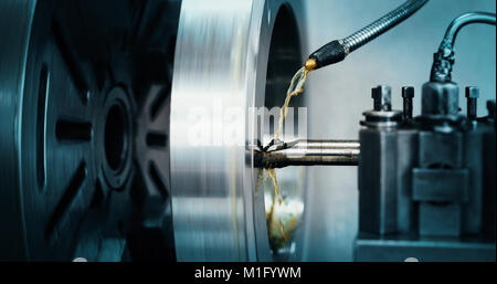 machine tool in metal factory with drilling cnc machines - Stock Photo