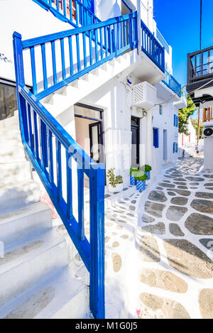 Mykonos, Greece. Whitewashed dotted alley in old city, Cyclades Greek Islands. - Stock Photo