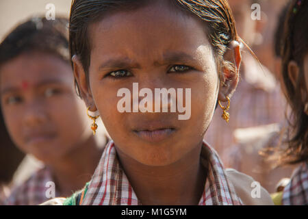 Close-up portrait of little schoolgirl in Bishnoi village, Dharamshala, Delhi, India - Stock Photo