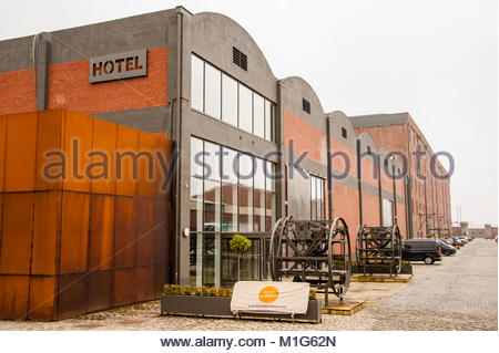 The back of the Titanic Hotel in Liverpool showing the entrance to the Rum Warehouse conference, events and banqueting - Stock Photo