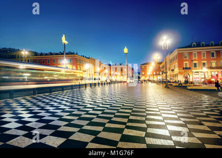 Cityscape with moving tram on Massena Square in downtown near famous Promenade des Anglais. Nice, France - Stock Photo
