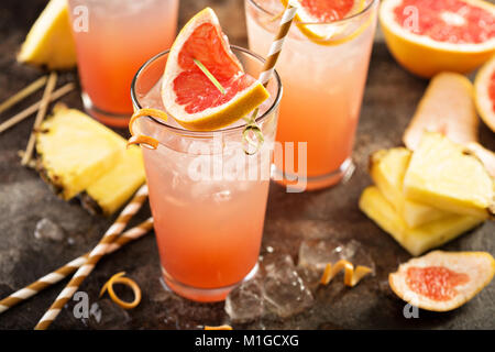 Grapefruit and pineapple cocktail or mocktail, refreshing drink with sparkling water - Stock Photo