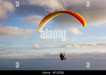Paragliders over the South Downs of East Sussex, UK - Stock Photo