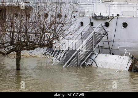 PARIS,FRANCE - January 29, 2018: The floating restaurants are seriously damaged on the Seine River that rose significantly. - Stock Photo
