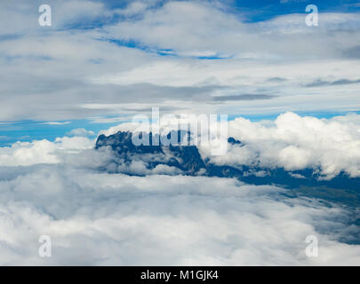 Aerial view of Mount Kinabalu hidden in the clouds, Borneo, Sabah, Malaysia - Stock Photo
