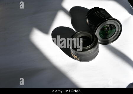 DSLR Lenses for wide angle and telephoto zooms - Stock Photo