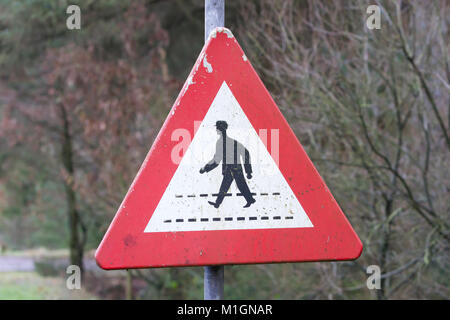 Old sign in the Netherlands - People crossing the road - Stock Photo