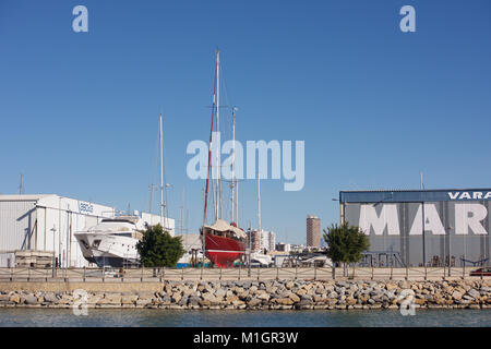 Yacht and Motor cruiser out of water at a shipyard - Stock Photo