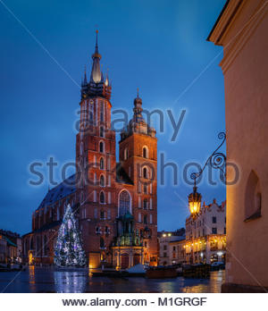 Market Square of Krakow and St. Mary's Basilica. Morning and lights - Stock Photo