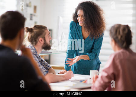 Meeting at office. a blackwoman discusses with her colleagues  - Stock Photo