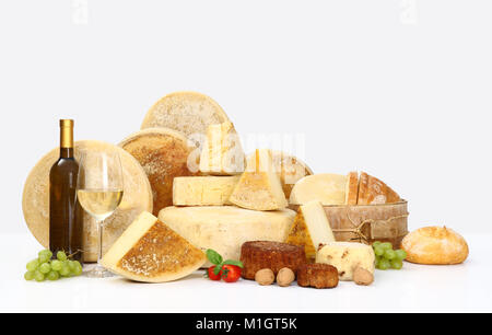 various types of cheese with wine, grapes, tomatoes, basil and bread - Stock Photo