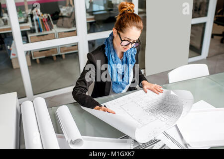 Architect working in the office - Stock Photo