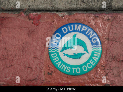 "Dolphin Sign On A Storm Drain In San Diego ""No Dumping Drains To Ocean"" Keep The Oceans Clean - Stock Photo"
