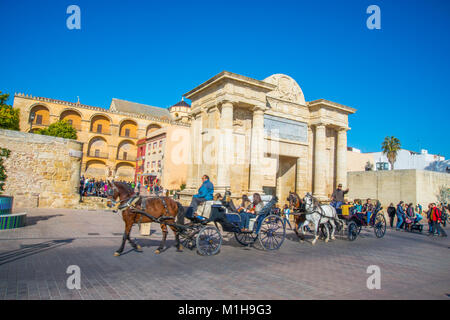 Horse-drawn carriages at Puerta del Puente. Cordoba, Spain. - Stock Photo
