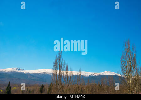 Snow covered mountains. Sierra de Guadarrama National Park, Madrid province, Spain. - Stock Photo