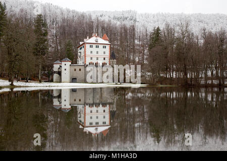 Winter idyllic landscape with reflection of castle Sneznik, Slovenia - Stock Photo