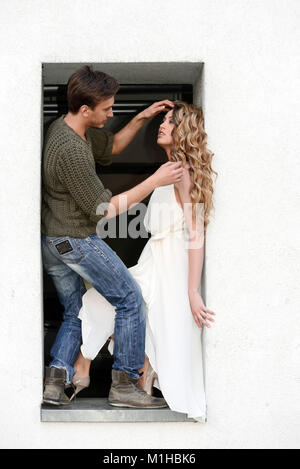 Stylist fixes hair on a model during fotoshoot outdoors, text space - Stock Photo