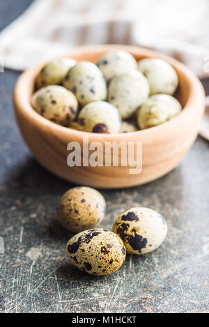 Fresh guail eggs in bowl. - Stock Photo