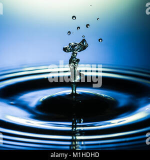 An abstract macro shot of a water drop collision. - Stock Photo