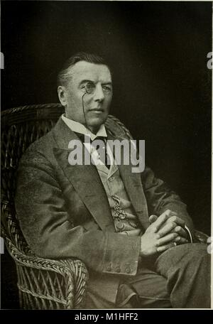 Black and white, three-quarter length, portrait photograph of English statesman Joseph Chamberlain, seated in a - Stock Photo