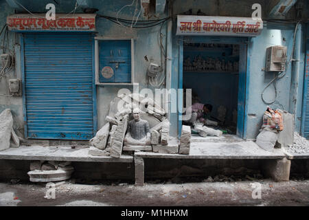 Worker making marble statues, Jaipur, India - Stock Photo