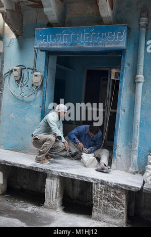 Workers making marble statues, Jaipur, India - Stock Photo