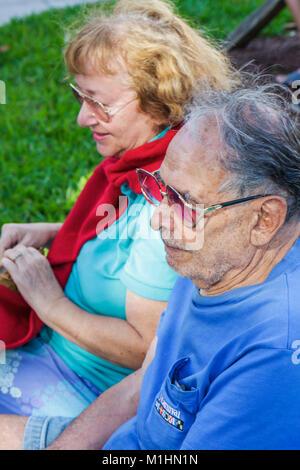 Miami Beach Florida Flamingo Park Arts in the Park senior man woman couple - Stock Photo