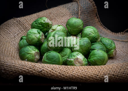 Brussel sprouts on hessian - Stock Photo