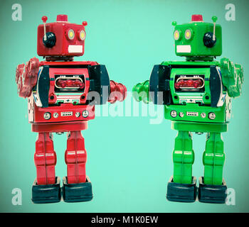two retro robot say  Hi on a light blue background - Stock Photo